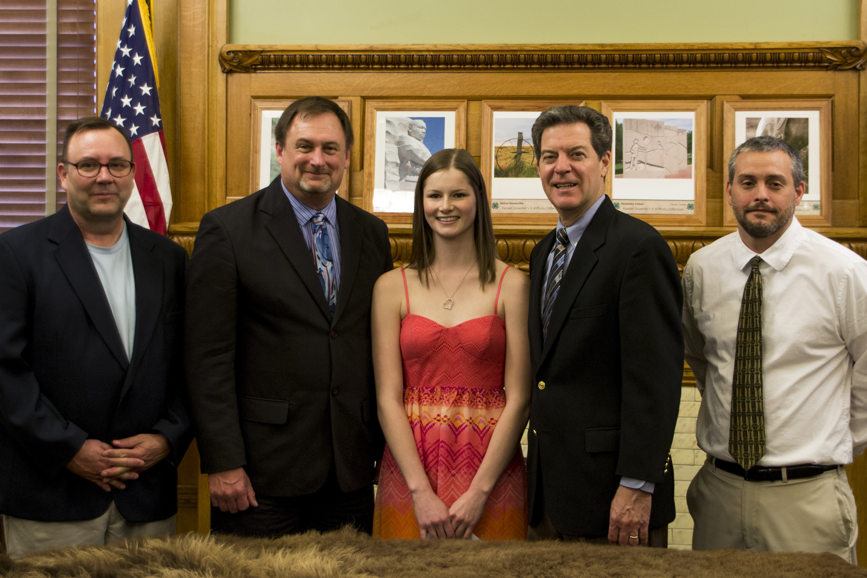 Governor Brownback posing for a photo with JAG participant and administrators.