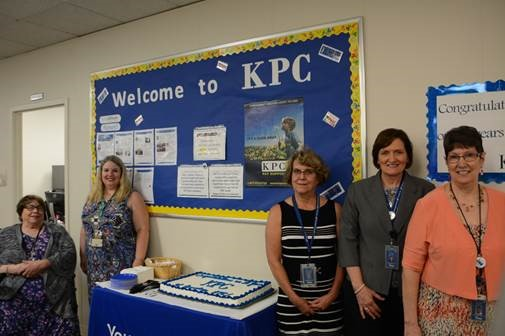 Left to right: DCF Secretary Phyllis Gilmore, Director of Child Support Services Trisha Thomas, KPC staff members Pam Underwood, Gina Hoffman and Jeanette Smith celebrate 10 years of successful KPC operation under YoungWilliams.