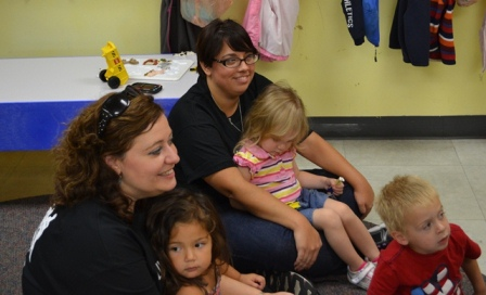 Deputy Secretary Anna Pilato, left, and Assistant Director Melissa Ward got to hold kids during storytime.
