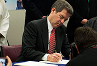 Governor Brownback signs the Kansas HOPE Act.